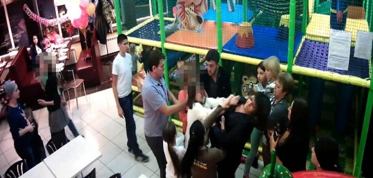 Pic shows: The cat fight between mums. A childrenís birthday party at a leisure centre turned into a vicious catfight between rowing young mums. And a drunk dad waded in punching one woman to the ground and pushing her over again after she tried to intervene. The extraordinary scenes were captured on video in the town of Serpukhov in Western Russia's Moscow Oblast. And young children looked on frozen with fear as their mothers, punched , kicked and pulled each otherís hair. The incident was sparked when a mum called Anastasia complained about the behaviour of one of the kids in the soft play area. It led to an ugly confrontation between Anastasia and the women who were attending the childrenís party. Serbian dad Negosh Bugarin,44 who had been drinking at the party, then waded in smashing one of the mothers to the floor as violence flared. Security guards had to move in and pull Anastasia away to safety after the other women were punching and kicking her and pulling her hair. The birthday party was ended on the spot and the group who had attacked Anastasia grabbed their children and left the scene just before police arrived. Police said Bugarin, who is known to them, drove through a red light on the way home and was accused of drink driving. Two years ago he was accused of hitting and kidnapping a man but the case was closed due to lack of evidence. (ends)