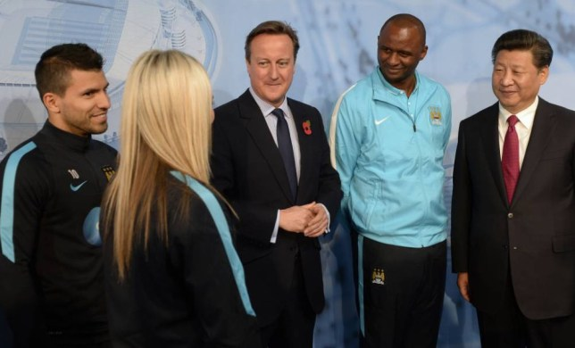 MANCHESTER, ENGLAND - OCTOBER 23: China's President Xi Jinping (R) and Britain's Prime Minister David Cameron (C) meet Manchester City's Sergio Kun Aguero (L), Manchester City Women's Toni Duggan (2L), head of the Elite Development Patrick Vieira (2R) during a visit to the City Football Academy on October 23, 2015 in Manchester, England. The President of the People's Republic of China, Mr Xi Jinping and his wife, Madame Peng Liyuan, are paying a State Visit to the United Kingdom as guests of The Queen. They will stay at Buckingham Palace and undertake engagements in London and Manchester. The last state visit paid by a Chinese President to the UK was Hu Jintao in 2005. (Photo by Joe Giddens - WPA Pool/Getty Images)