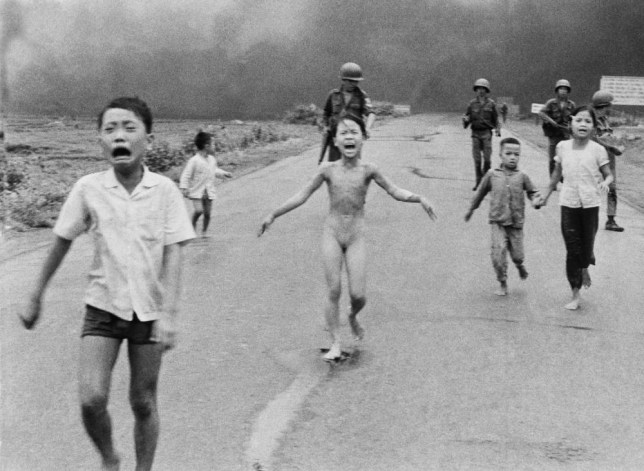 FILE - In this June 8, 1972, file photo, 9-year-old Kim Phuc, center, runs with her brothers and cousins, followed by South Vietnamese forces, down Route 1 near Trang Bang after a South Vietnamese plane accidentally dropped its flaming napalm on its own troops and civilians. The terrified girl had ripped off her burning clothes while fleeing. In late September 2015, Phuc, 52, began a series of laser treatments at the Miami Dermatology and Laser Institute to smooth and soften the pale, thick scar tissue that she has endured for more than 40 years. (AP Photo/Nick Ut, File)