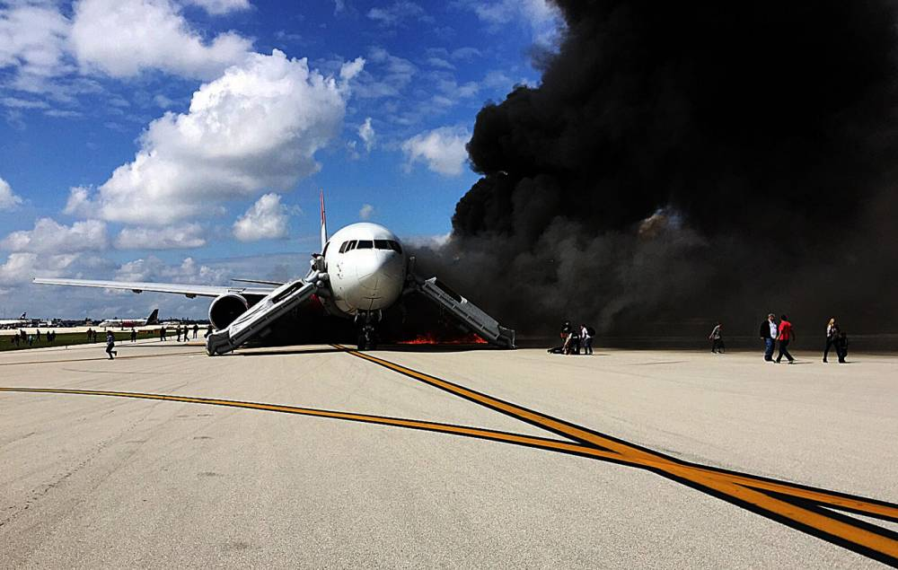 "Passengers evacuate from the plane on fire at Fort Lauderdale airport, Florida on October 29, 2015. An airliner caught fire on a runway at Fort Lauderdale in Florida Thursday and several people were injured, authorities said. ""Airplane engine fire,"" the Broward County Sheriff's Office said on Twitter, adding: ""several injuries."" AFP PHOTO / ANDRES GALLEGOANDRES GALLEGO/AFP/Getty Images"