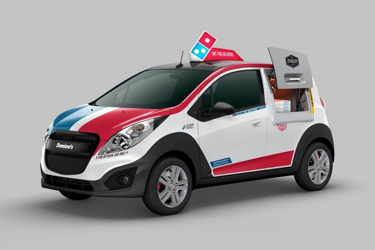 dominos car with very own pizza oven