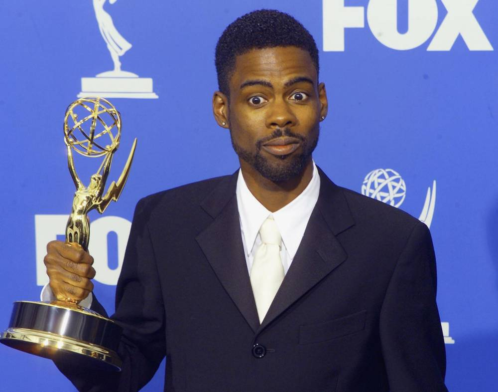 """Comedian Chris Rock holds his Emmy Award for Outstanding Writing for a Variety, Music or Comedy Program for """"The Chris Rock Show"""" at the 51st Emmy Awards at the Shrine Auditorium in Los Angeles 12 September, 1999. AFP PHOTO (ELECTRONIC IMAGE) Scott NELSON ...ACE...TELEVISION"""
