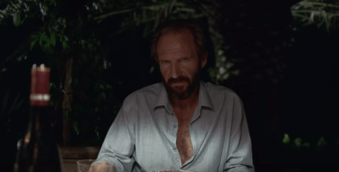 Ralph Fiennes gets totally obscene in the first trailer for A Bigger Splash