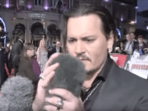 Johnny Depp couldn't get enough of a furry microphone at the Black Mass premiere
