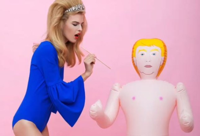 donald trump blow up dolls being poked by glamourous woman