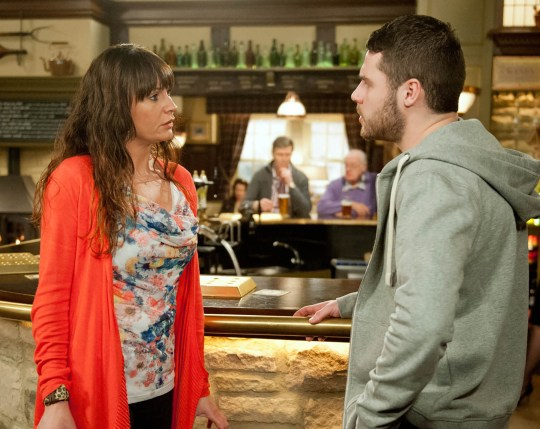 FROM ITV STRICT EMBARGO - No Use Before Tuesday 17 November 2015 Emmerdale - Ep 735253 Tuesday 24 November 2015 when Emma and James arrive at the pub together, Chas Dingle [LUCY PARGETTER] wants Aaron Livesy [DANNY MILLER] to call the police, but he decides against it. Aaron's pained to realise the full impact of Emma's return. Picture contact: david.crook@itv.com on 0161 952 6214 Photographer - Amy Brammall This photograph is (C) ITV Plc and can only be reproduced for editorial purposes directly in connection with the programme or event mentioned above, or ITV plc. Once made available by ITV plc Picture Desk, this photograph can be reproduced once only up until the transmission [TX] date and no reproduction fee will be charged. Any subsequent usage may incur a fee. This photograph must not be manipulated [excluding basic cropping] in a manner which alters the visual appearance of the person photographed deemed detrimental or inappropriate by ITV plc Picture Desk. This photograph must not be syndicated to any other company, publication or website, or permanently archived, without the express written permission of ITV Plc Picture Desk. Full Terms and conditions are available on the website www.itvpictures.com