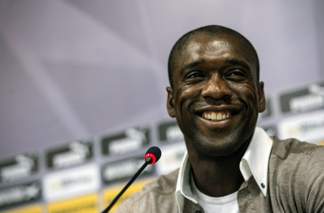 Botafogo's Dutch player Clarence Seedorf smiles during a press conference at Engenhao stadium in Rio de Janeiro, Brazil, on January 14, 2014. Seedorf announced his resignation to Botafogo and confirmed he is taking over as coach of AC Milan, replacing Massimiliano Allegri. AFP PHOTO / YASUYOSHI CHIBA (Photo credit should read YASUYOSHI CHIBA/AFP/Getty Images)