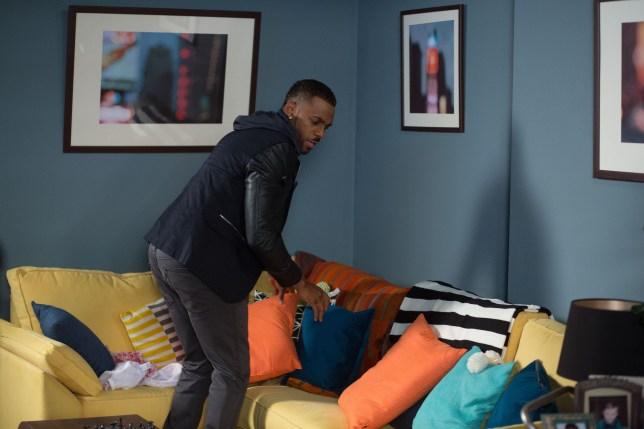 WARNING: Embargoed for publication until 00:00:01 on 17/11/2015 - Programme Name: EastEnders - TX: 27/11/2015 - Episode: 5180 (No. n/a) - Picture Shows: Vincent searches for a missing item Vincent (RICHARD BLACKWOOD) - (C) BBC - Photographer: Jack Barnes