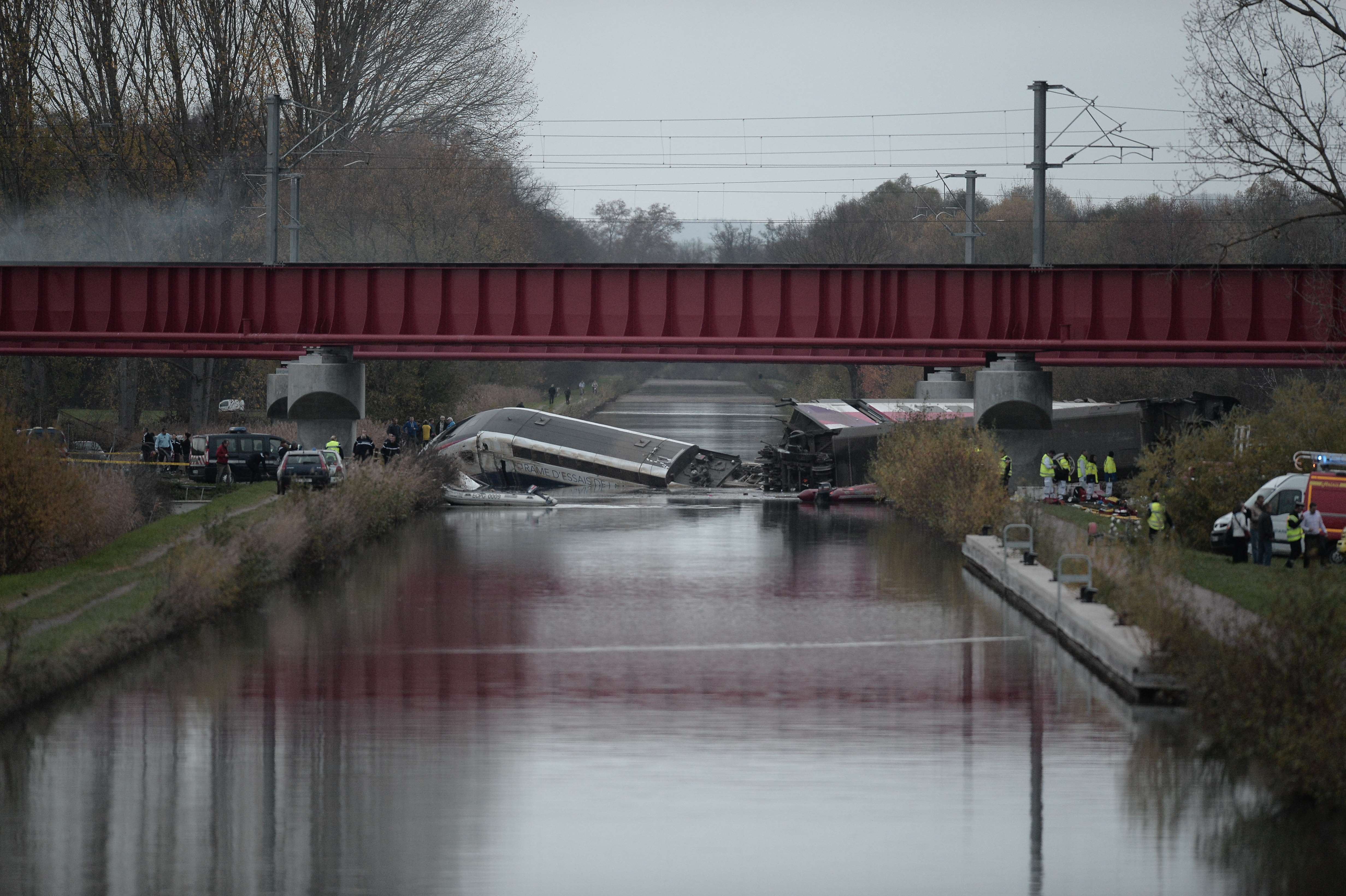 A high-seepd TGV train coach and engine carriage lie in a canal in Eckwersheim near Strasbourg, northeastern France, after derailing on November 14, 2015 during tests conducted by technicians, Frenh railway operator SNCF said. At least five were killed in French high-speed train test on November 14, due to excessive speed, sources said. AFP PHOTO / FREDERICK FLORINFREDERICK FLORIN/AFP/Getty Images