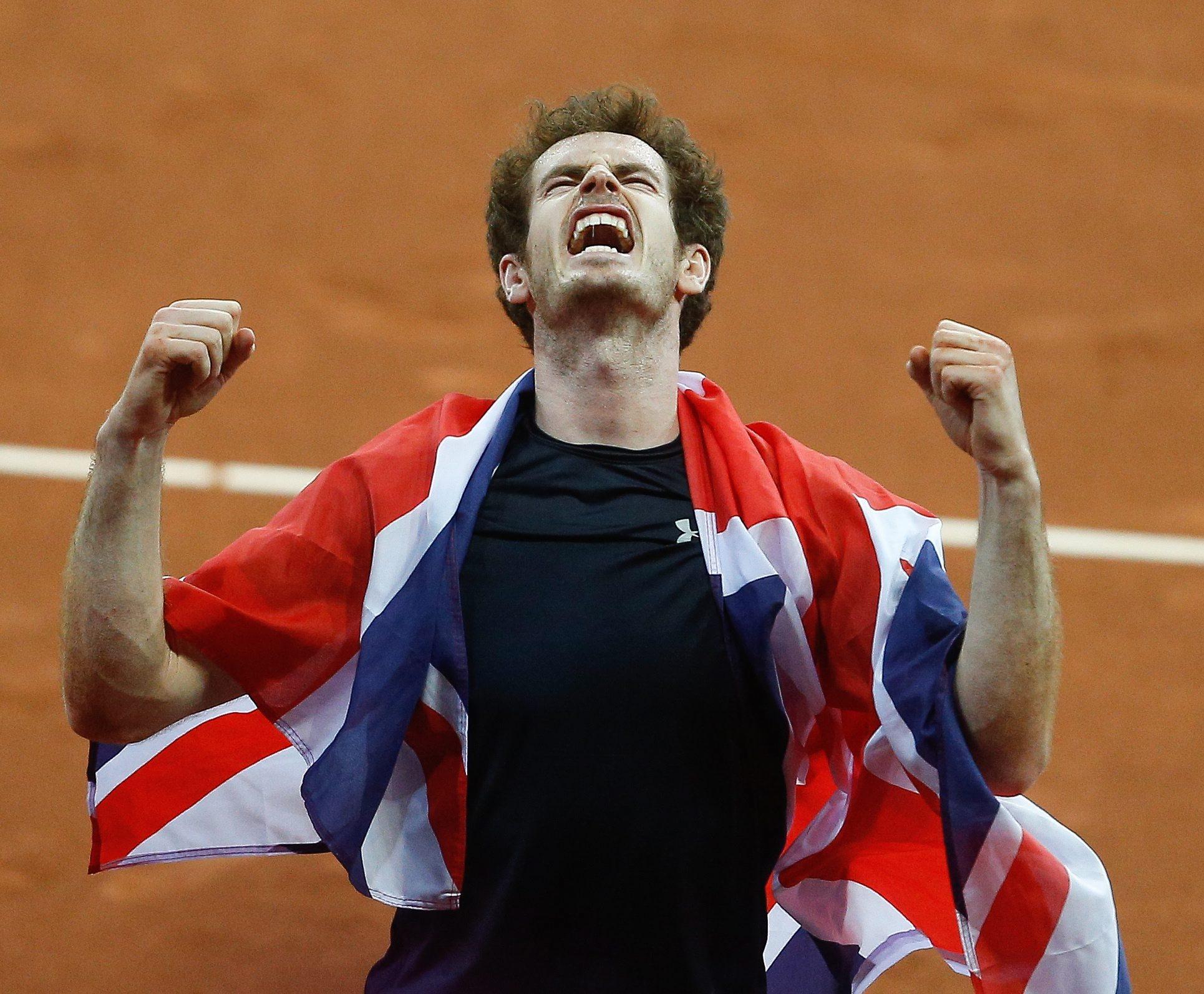 epa05047529 Britain's Andy Murray celebratres winning against Belgium's David Goffin during the Davis Cup World Group Final between Belgium and Britain in Gent, Belgium, 29 November 2015. EPA/LAURENT DUBRULE