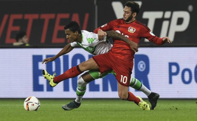 Leverkusen's midfielder Hakan Calhanoglu (R) and Wolfsburg's Brazilian midfielder Luiz Gustavo vie for the ball during the German first division Bundesliga football match Wolfsburg vs Leverkusen in Wolfsburg on October 31, 2015. AFP PHOTO / TOBIAS SCHWARZ RESTRICTIONS: DURING MATCH TIME: DFL RULES TO LIMIT THE ONLINE USAGE TO 15 PICTURES PER MATCH AND FORBIDS IMAGE SEQUENCES TO SIMULATE VIDEO. == RESTRICTED TO EDITORIAL USE == FOR FURTHER QUERIES PLEASE CONTACT DFL DIRECTLY AT + 49 69 650050.TOBIAS SCHWARZ/AFP/Getty Images