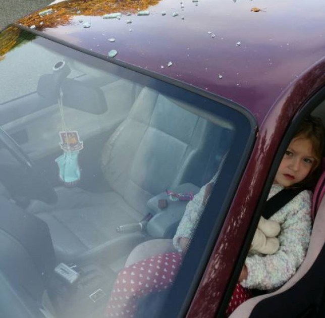 PIC FROM CATERS NEWS - (PICTURED: Lily-Mae in the car ) - A road rage thug has left a little girl terrified and her father injured as he punched a car window so hard it smashed showering the five year old with glass. The incident left Karl Williams, 35, with a black eye, a cut on the bridge of his nose and blurred vision - and his daughter, Lily-Mae, terrified. Karl, from Worcester, West Midlands, had been driving down the A38 dual carriageway in Droitwich on Saturday morning (31 October), when another driver signalled to him to pull over. SEE CATERS COPY.