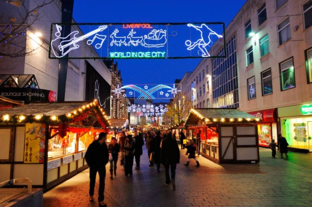 BWX56T Christmas shoppers enjoying the European Market in Liverpool City Centre
