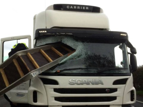 Lorry driver narrowly escaped death after metal platform smashed through windscreen