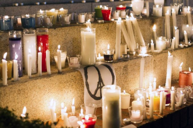 View of candles at Duarte square in Santo Domingo on November 15, 2015, in tribute to the victims of Paris' attacks. Islamic State jihadists claimed a series of coordinated attacks by gunmen and suicide bombers in Paris on November 13 that killed at least 129 people in scenes of carnage at a concert hall, restaurants and the national stadium. AFP PHOTO/ERIKA SANTELICESERIKA SANTELICES/AFP/Getty Images