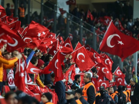 Watch Turkish football fans loudly boo their pre-match minute's silence for Paris victims