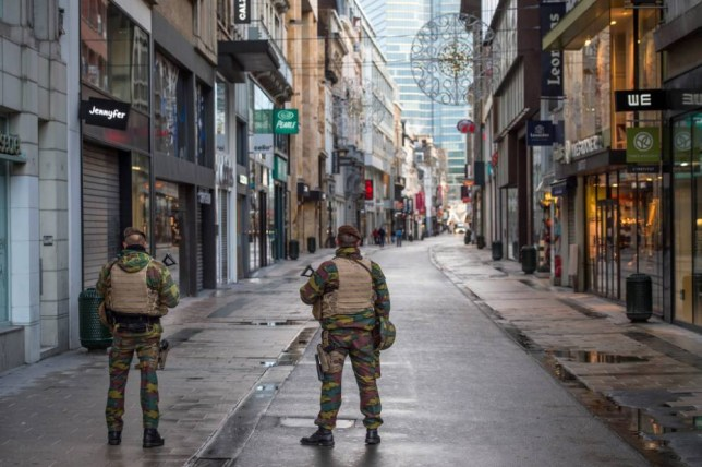 epa05036779 Belgian soldiers patrol in Rue Neuve, the busiest shopping street in Brussels, now empty due to the terror alert level being elevated to 4/4, in Brussels, Belgium, 21 November 2015. Belgium raised the alert status at Level 4/4 as 'serious and imminent' threat of an attack, the main effect are closing of all Metro Line in Brussels, all soccer match of league one and two cancelled countrywide. The Belgian government said it had concrete evidence of a planned terrorist attack that would have employed weapons and explosives. EPA/STEPHANIE LECOCQ
