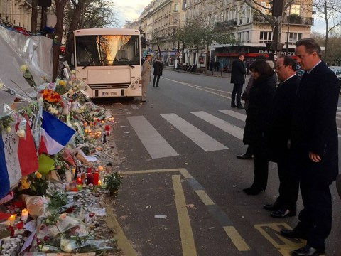David Cameron and François Hollande pay respects at Bataclan Café