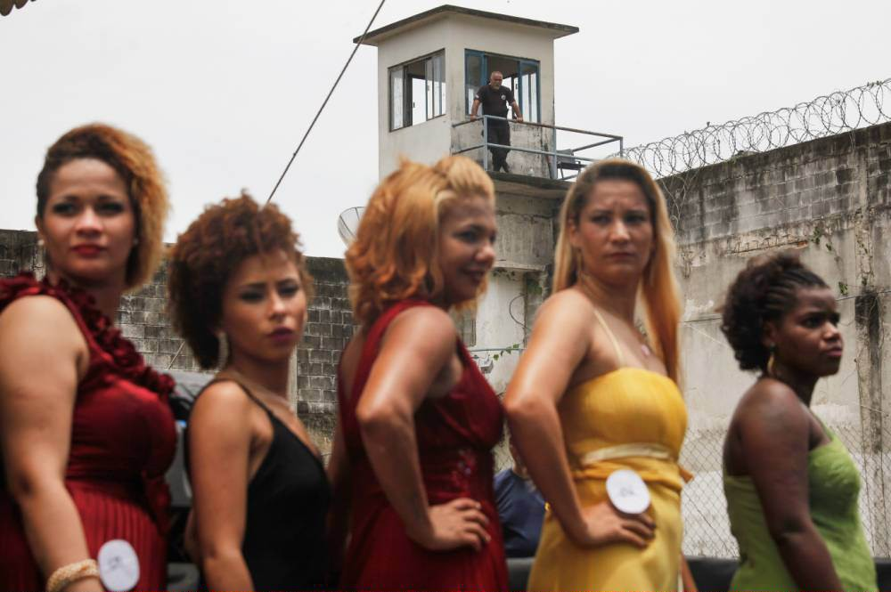 RIO DE JANEIRO, BRAZIL - NOVEMBER 24: Inmate contestants stand during the annual beauty pageant at the Talavera Bruce women's prison on November 24, 2015 in Rio de Janeiro, Brazil. The pageant aims to humanize and boost the self-esteem of female inmates who receive makeup and hair styling from volunteers. According to the Ministry of Justice, the number of imprisoned females in the country rose 567 percent from 2000 to 2014. Overall, Brazil's overcrowded prison population is now the world's fourth largest, with more than 600,000 inmates being held in facilities designed for 377,000, according to Human Rights Watch. (Photo by Mario Tama/Getty Images)