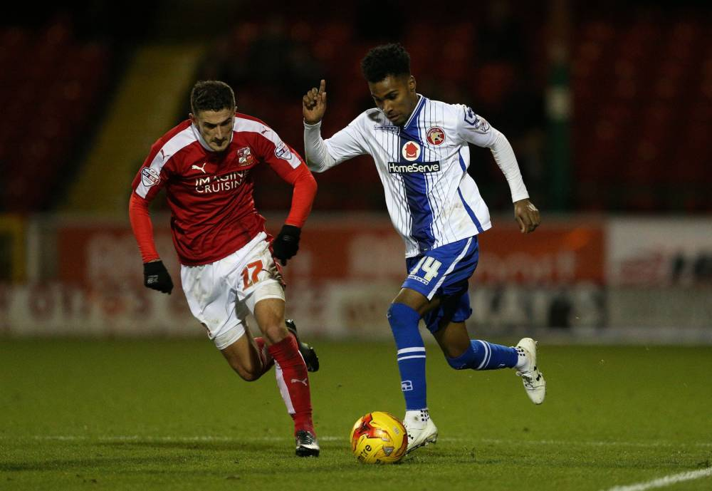 """Walsall's Rico Henry gets past Swindon Town's Bradley Barry during the Sky Bet League One match at the County Ground, Swindon. PRESS ASSOCIATION Photo. Picture date: Tuesday November 24, 2015. See PA story SOCCER Swindon. Photo credit should read: David Davies/PA Wire. RESTRICTIONS: EDITORIAL USE ONLY No use with unauthorised audio, video, data, fixture lists, club/league logos or """"live"""" services. Online in-match use limited to 75 images, no video emulation. No use in betting, games or single club/league/player publications."""