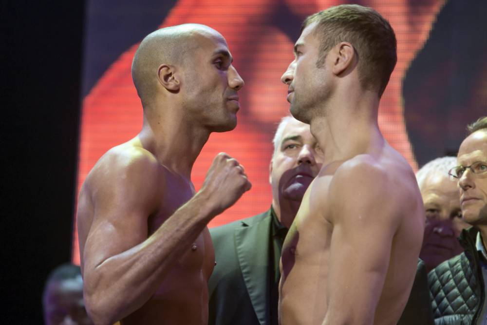 James DeGale, left, and Lucian Bute face each other at the weigh-in in Quebec City, Quebec on Friday, Nov. 27, 2015, for their IBF super-middleweight title fight. The fight will be held on Saturday at the Videotron Centre in Quebec City. (Francis Vachon/The Canadian Press via AP) MANDATORY CREDIT