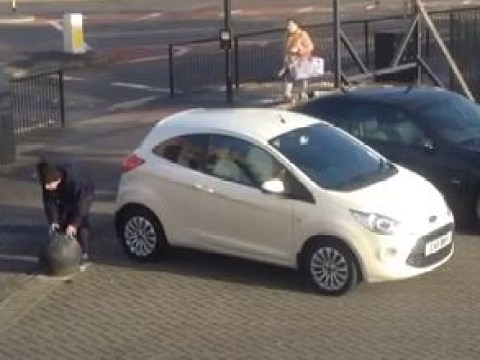 Drunk guy in Romford tries to move concrete bollard with his bare hands