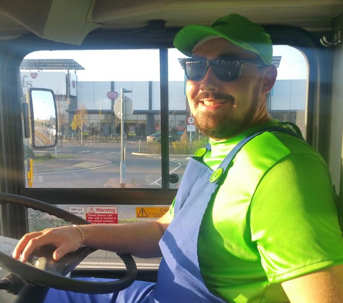 Epic bus driver dresses as Luigi and whistles the Super Mario theme tune