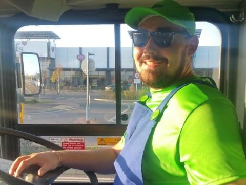 Epic bus driver dresses as Luigi and whistles the Super Mario theme tune