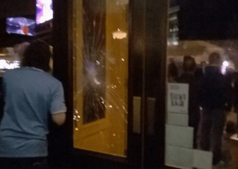 Manchester City fans forced to take cover in a bar after coming under attack in Seville