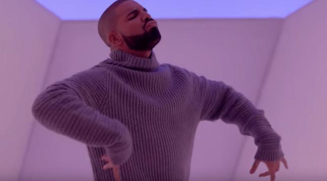 drake wearing a cosy jumper hotline bling jumper