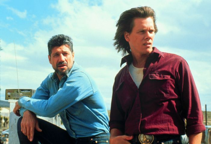 Film: Tremors (1990), Starring Kevin Bacon as Valentine McKee and Fred Ward as Earl Basset