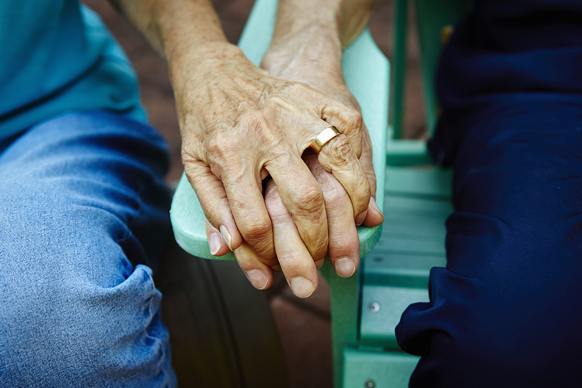 Elderly couple found holding hands after setting bedroom on fire in joint suicide
