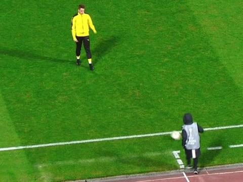 Manchester United's Adnan Januzaj warms up for Borussia Dortmund match with ball-boy