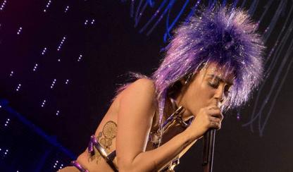 RIP Hannah Montana! Miley Cyrus opens gig wearing purple wig and fake penis