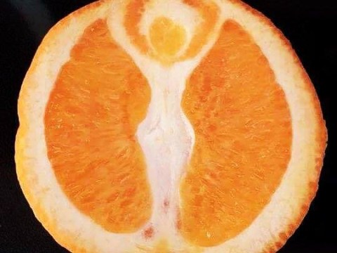 Just the figure of a goddess, chilling in an orange