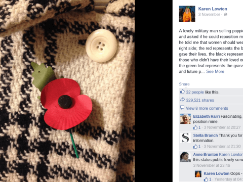 Woman stopped in street to have her poppy re-positioned and explained by ex-military man