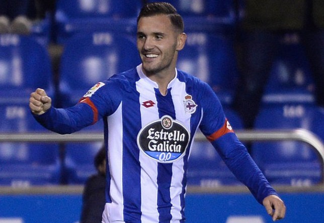 Deportivo La Coruna's midfielder Lucas Perez celebrates after scoring a goal during the Spanish league football match RC Deportivo de la Coruna vs Sevilla FC at the Municipal de Riazor stadium in La Coruna on December 5, 2015. / AFP / MIGUEL RIOPA (Photo credit should read MIGUEL RIOPA/AFP/Getty Images)
