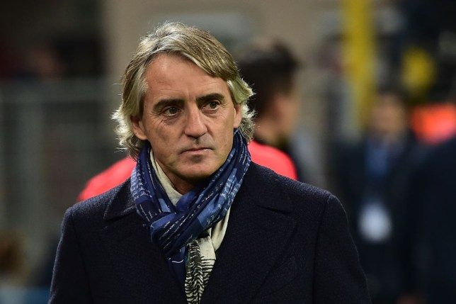 Inter Milan's head coach from Italy Roberto Mancini looks on before the Serie A football match between Inter and Lazio at San Siro Stadium in Milan on December 20, 2015. / AFP / GIUSEPPE CACACE (Photo credit should read GIUSEPPE CACACE/AFP/Getty Images)