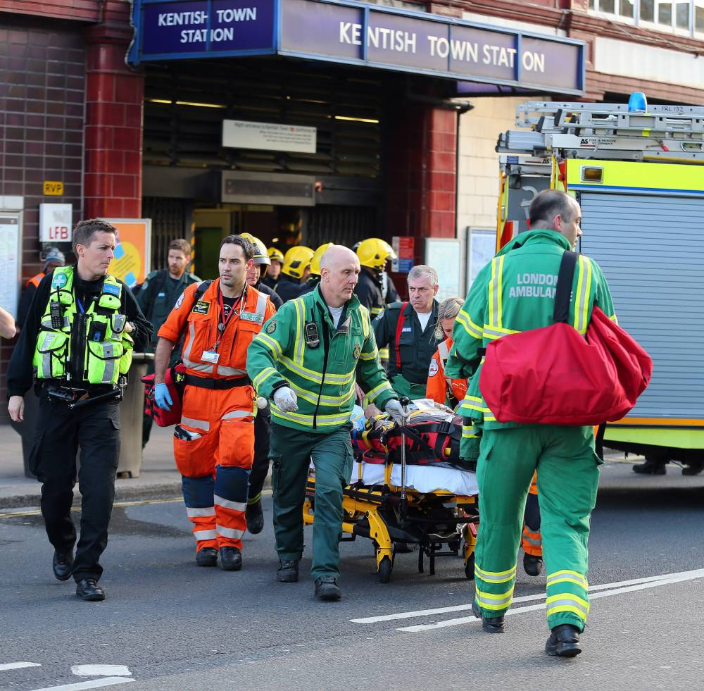 Paramedics carry a seriously injured man on a stretcher from Kentish Town underground station. The man was allegedly pushed into an oncoming train early today. London. UK. 02/12/2015 BYLINE MUST READ : JAMESY/GOTCHA IMAGES Copyright by © Gotcha Images Ltd. All rights reserved. Usage of this image is conditional upon the acceptance of Gotcha Images Ltd, terms and conditions available at www.gotchaimages.com