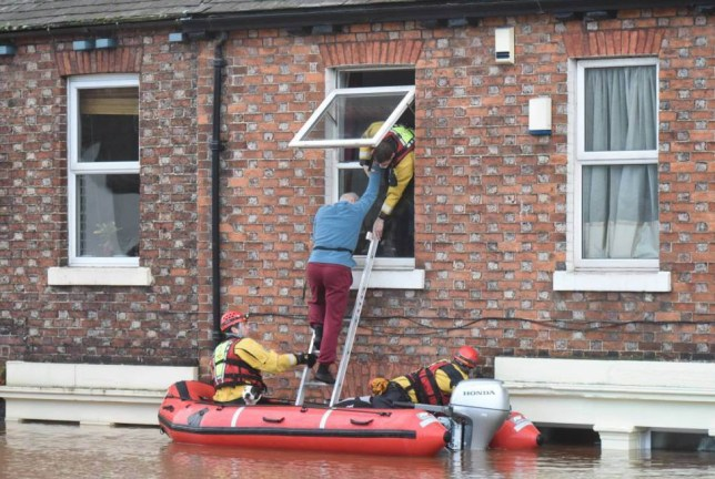 Dated: 06/12/2015 RNLI and Fire Rescue teams use inflatable boats to rescue residents and their pets from first floor windows in Carlisle this morning (SUN) which has been engulfed in flood water following record breaking rainfall across the North West caused by Storm Desmond. See story and VIDEO by North News