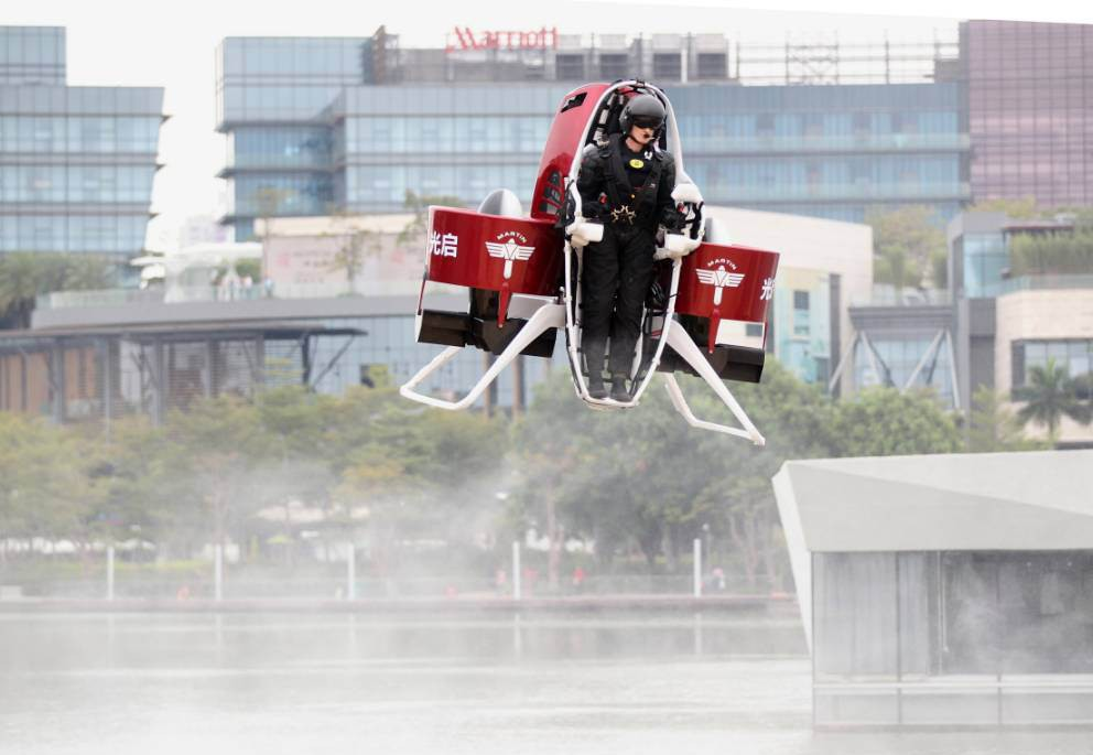 SHENZHEN, CHINA - DECEMBER 06: (CHINA OUT) Michael Read, Director of Flight Operations from New Zealand-based Martin Aircraft Company, flies on a Martin Jetpack over a water park on December 6, 2015 in Shenzhen, China. A Martin Aircraft made its first China public flight demonstration in Shenzhen. KuangChi Science Ltd, a Hong Kong-listed company and investor of Martin Aircraft, priced the flying machine at 1.6 million yuan (about 249,902 USD). (Photo by ChinaFotoPress/ChinaFotoPress via Getty Images)