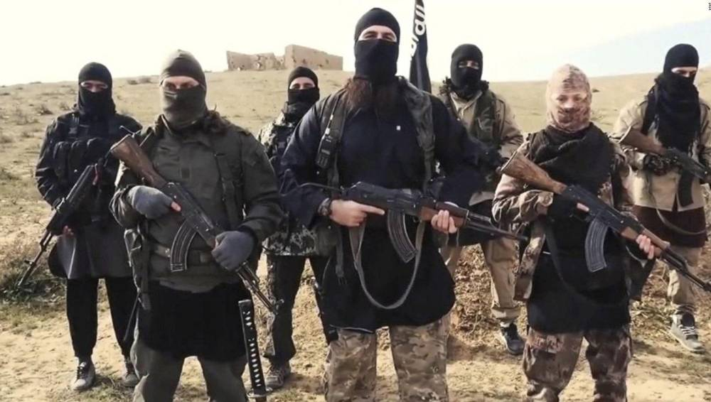 F6RX37 Islamic State of Iraq and the Levant propaganda photo showing masked militants in Syria.