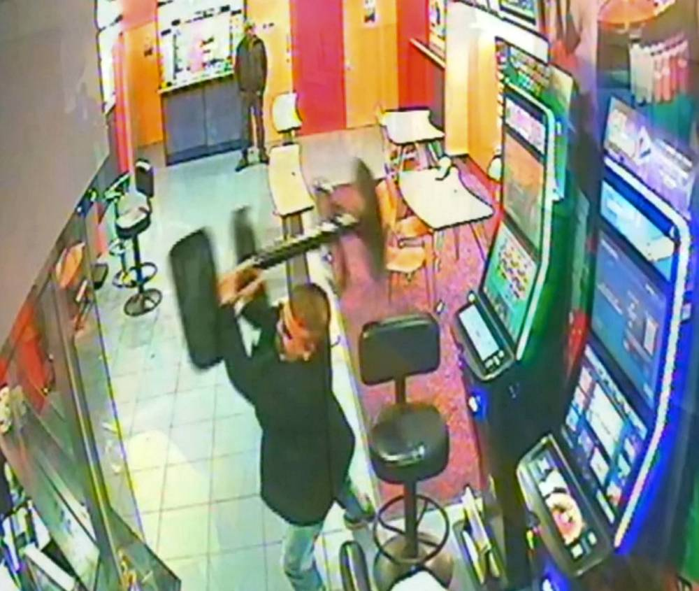 This is the astonishing moment an angry punter lost his rag and smashed up a Coventry bookies with a metal stool, causing £2,000-worth of damage. See NTI story NTIBET. The incredible scenes were captured on CCTV at the William Hill branch in Far Gosford Street on Friday, November 27. The irate customer is seen picking up the large stool at around 8.20pm and smashing it against a gambling machine three times, before turning his attention to the glass window by the tills.