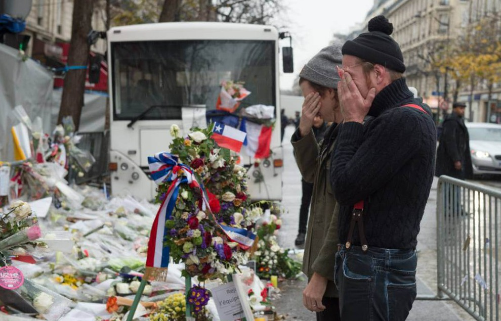 PARIS, FRANCE - DECEMBER 08: Eagles of Death Metal frontman Jesse Hughes (R) and drummer Julian Dorio visit a memorial that pays homage to the victims of the terrorist attacks at Le Bataclan on December 8, 2015 in Paris, France. The Eagles of Death Metal band returned to the Bataclan concert hall for the first time since the deadly terrorist attacks on November 13th where 130 people lost their lives and many more were injured. (Photo by David Wolff - Patrick/Getty Images)