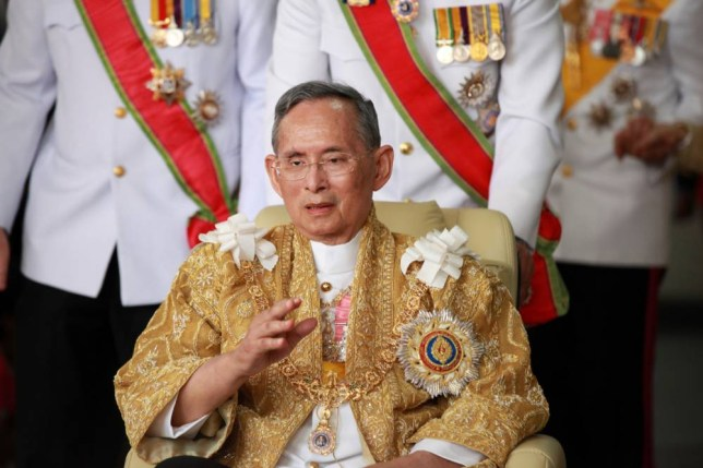 Thailand's King Bhumibol Adulyadej waves as he returns from the Grand Palace to Siriraj Hospital in Bangkok on December 5, 2011 on his 84th birthday. Thailand's king, the world's longest reigning monarch, left the hospital where he has been staying for more than two years and addressed his subjects to mark his 84th birthday. AFP PHOTO / Pairoj (Photo credit should read PAIROJ/AFP/Getty Images)