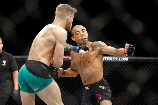 Conor McGregor knocks out Jose Aldo during a featherweight championship mixed martial arts bout at UFC 194, Saturday, Dec. 12, 2015, in Las Vegas. (AP Photo/John Locher)