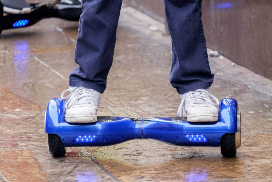 Mandatory Credit: Photo by Ray Tang/REX Shutterstock (5491457f) Teenager using a hoverboard on the pavement Teenagers using hoverboards, London, Britain - 13 Dec 2015