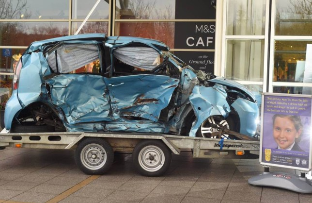 Pictured: The Staley family car on display in Hedge End near Southampton. Grieving parents are displaying the smashed-up family car their 10-year-old daughter died in a desperate bid to shock drivers out of drinking this Christmas. Heartbroken Neal and Penny Staley agreed for the blue Subaru Justy to visit busy High Street as a stark warning to boozed-up revellers thinking of getting behind the wheel. The car will be shown in locations around Hampshire and the Isle of Wight to raise awareness of the devastating consequences of drink-driving as part of this year's police campaign. SEE OUR COPY FOR DETAILS. © Solent News & Photo Agency UK +44 (0) 2380 458800