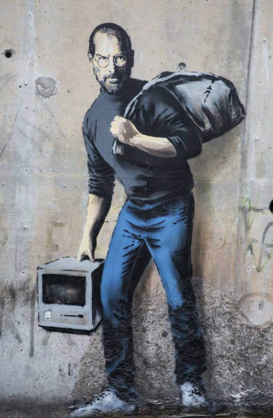 Mandatory Credit: Photo by REX/Shutterstock (5491762a) Banksy graffiti art of Steve Jobs as a refugee Banksy graffiti art of Steve Jobs at The Jungle migrant camp, Calais, France - 14 Dec 2015
