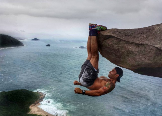 PIC FROM CATERS NEWS - (PICTURED: Luis Fernando Candela hangs from the cliff face ) - Talk about rock hard abs! These incredible photographs show a daredevil hanging over a 10,000ft drop with nothing but his abs holding him up. The photographs, taken in Pedra do Telegrafo, Brazil, show daredevil Luis Fernando Candela, hanging from a cliff face with spectacular views of the Pedra Branca national park in the background. Luis, from Rio de Janeiro, Brazil, was photographed by his terrified girlfriend on Saturday 21 November as she watched her boyfriend show incredible strength to hang from the rock. SEE CATERS COPY.